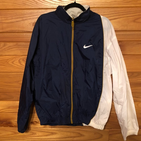 f7d65135d4a2 90s Navy Blue and White Nike Windbreaker